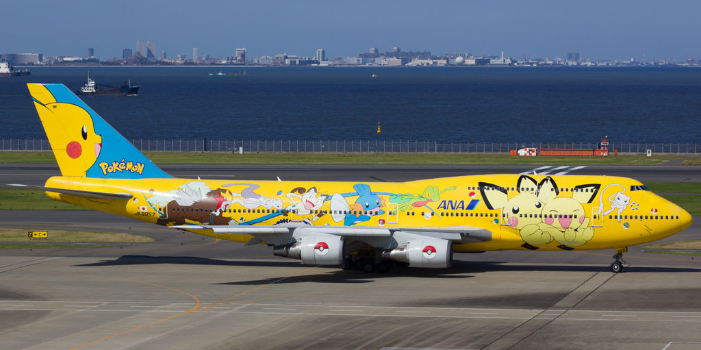 ANA airplane featuring artwork of Mew and Mewtwo, among several other Pokemon.